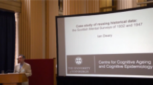 Ian deary next to a screen that reads 'Case Study of reusing historical data, the scottish mental surveys of 1932 and 1947