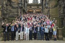 Large group of cohort members on the stairs of Assembly Hall, Edinburgh