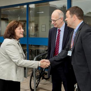 Jeane Freeman shakes hands with Professor Andrew McIntosh and Professor Jonathan Seckl